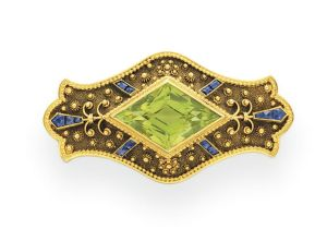 AN-ANTIQUE-PERIDOT-SAPPHIRE-AND-GOLD-BROOCH-BY-GILLOT-CO.-CIRCA-1890-Photo-courtesy-of-Christies