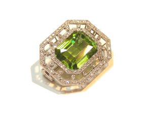 An-Edwardian-gem-set-brooch-by-Cartier-with-octagon-cut-peridot-and-rose-cut-diamonds-circa-1902-1909-Photo-courtesy-of-Wartski