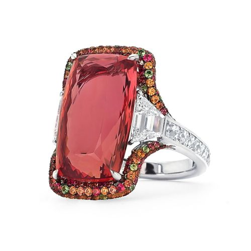 Martin Katz Imperial Topaz Ring 18 carat imperial topaz ring, with two step-cut trapezoid diamonds and micro-set with diamonds, sapphires, tsavorite garnets and tourmalines