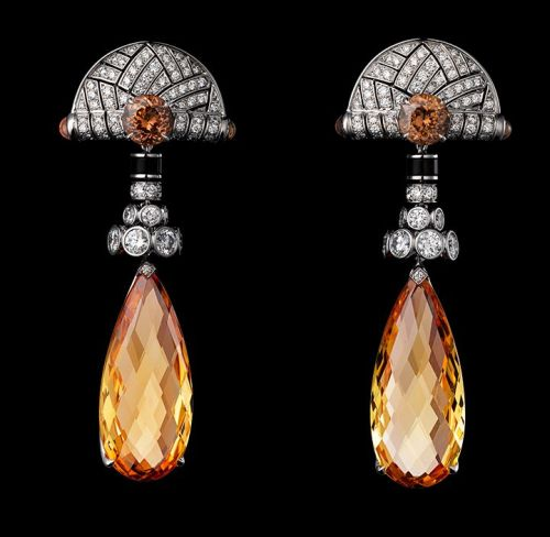 Platinum-two-briolette-cut-golden-imperial-topazes-totaling-28.11-carats-cabochon-cut-colored-sapphires-round-colored-sapphires-obsidian-brilliants.