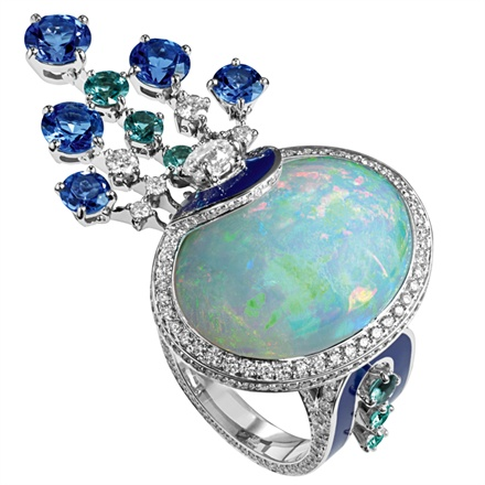 Chaumet Ring in white gold set with a18.13 carat cabochon-cut white opal, diamanti, blue tourmaline and tanzanites.