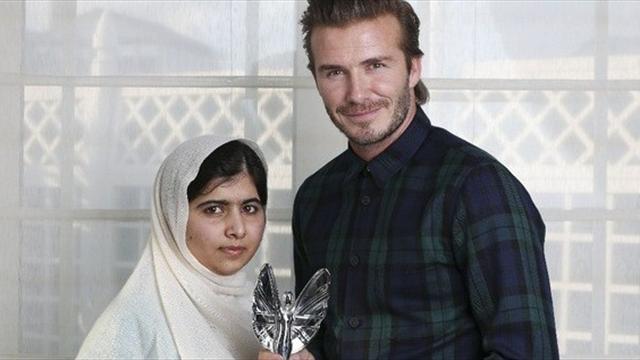 Малала и какой-то футболист