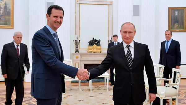 Президент Сирии Башар Асад и президент России Владимир Путин во время встречи в Кремле