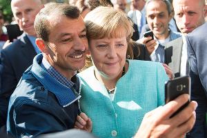 Беженцы и Меркель