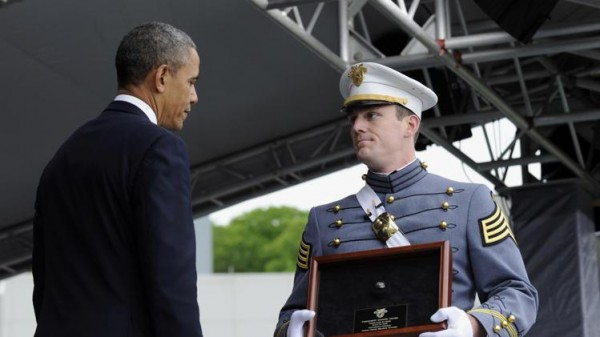 President Barack Obama is presented with the Class Battle Ring from Class President Jeffrey Ferebee during commencement ceremonies at the U.S. Military Academy at West Point's Class of 2014, in West Point, N.Y., Wednesday, May 28, 2014. (AP Photo/Susan Walsh)