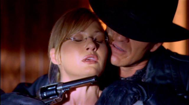 OK, I know he's got a gun on her, but damn, this is a sexy shot.