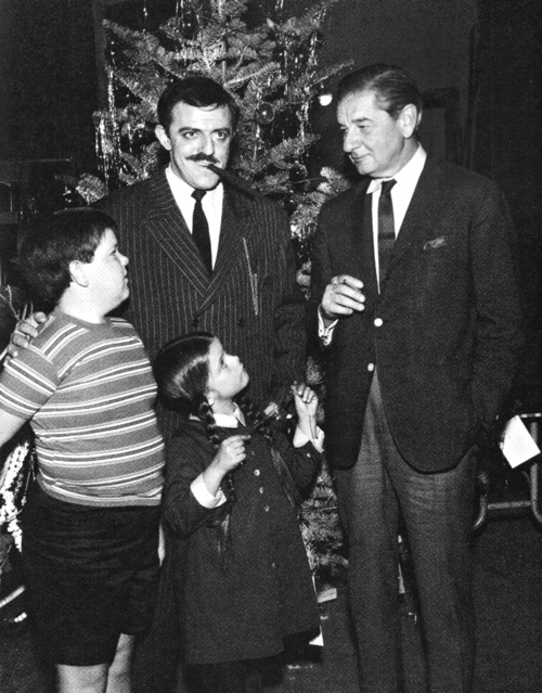 Charles Addams visiting the set of The Addams Family.  At Christmastime!  c. 1960s