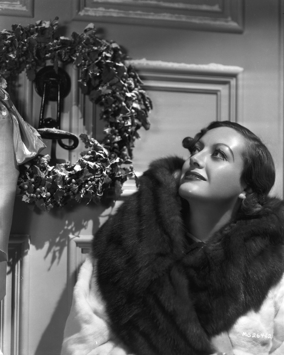 Joan Crawford with her Christmas wreath