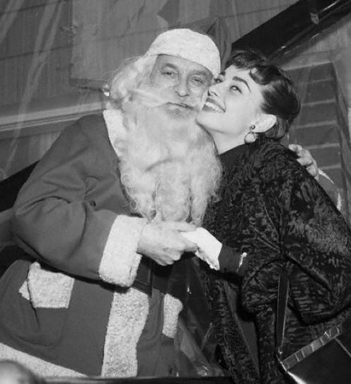 Audrey Hepburn and Santa 1950s