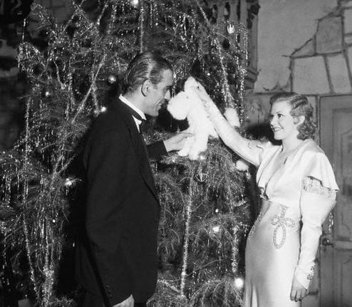 Boris Karloff and Ginger Rogers at a gala Hollywood Christmas party - 1932