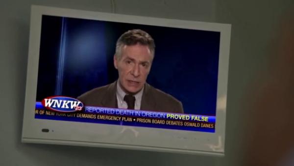 Robin Sachs seen on a TV screen