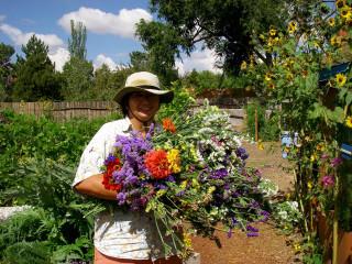 Moria Peters in her garden with flowers