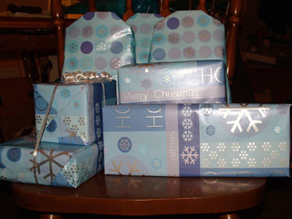 the wrapped gifts sitting on a dining chair