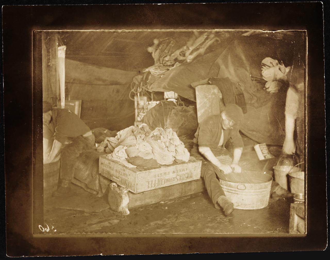 NPRA437._Roald_Amundsen_vasker_klær_om_bord_i__Maud__-_Roald_Amundsen_doing_laundry_aboard_the__Maud__(16911137910).jpg