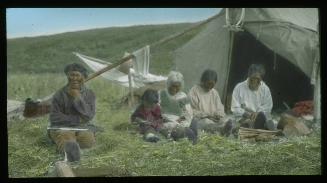 Handcolored_Inuit_group_seated_outside_a_tent.jpg