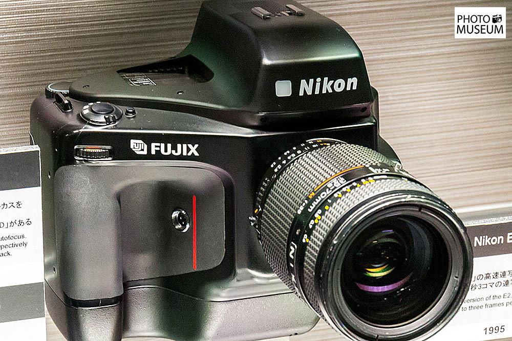 1280px-Nikon_E2S_front-right_2015_Nikon_Museum.jpg