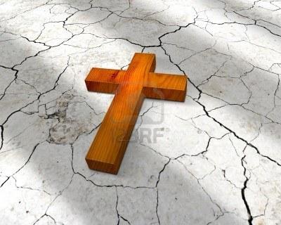 6247093-wooden-cross-lying-on-cracks