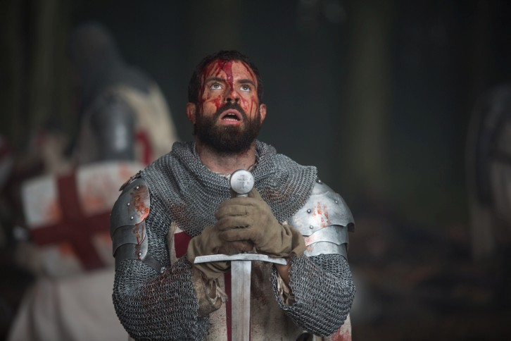 tom_cullen_as_landry_bowed_before_his_sword_in_historys_new_drama_series_knightfall.jpg