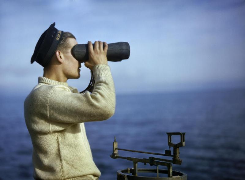 Leading_Seaman_Walker_keeps_a_look-out_from_the_bridge_of_HM_Submarine_TRIBUNE,_September_1942._TR596