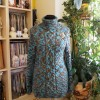 Меланжевый свитер на манекене