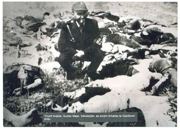 Facist Ustasa man poses among victims of Jasenovac