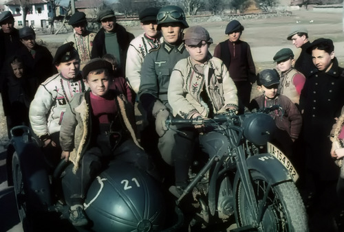 wehrmacht_soldier_with_kids___bulgaria__1941_by_cainisnotmyenemy-d5txhro