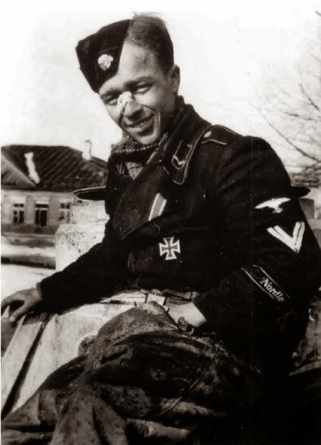 Danish volunteer SS Sturmann Kurt Tebring perched on his Panther Ausf D