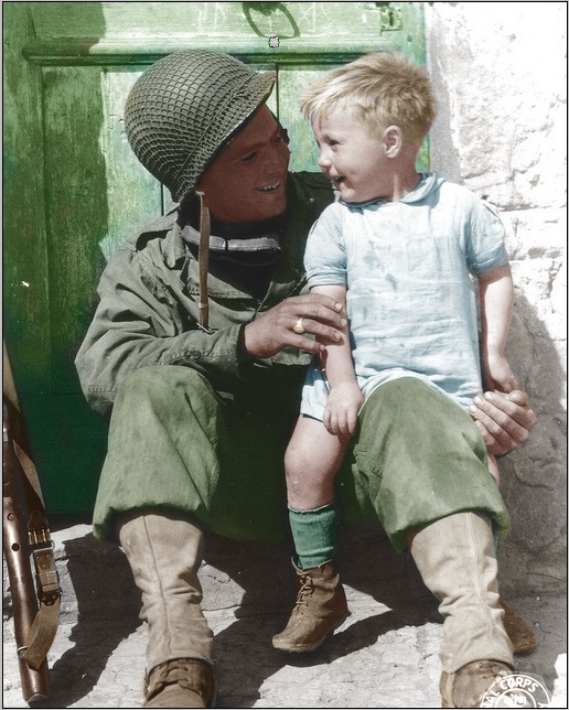 US soldier and kid france 1944
