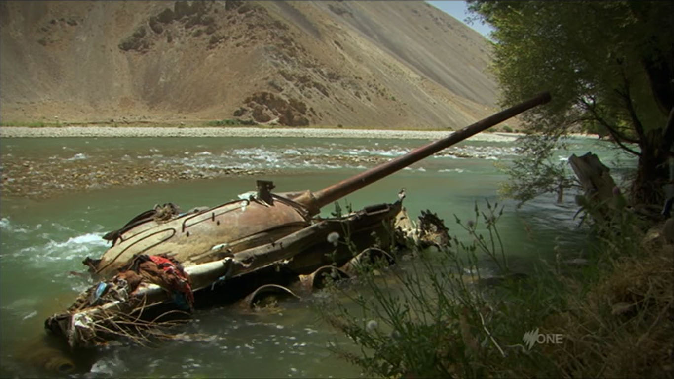 russian-tank-disabled-destroyed-river-afghanistan-rusting.jpg