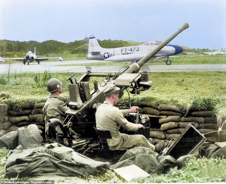 7276698-6482847-US_soldiers_man_the_guns_THE_HORRORS_of_the_Korean_War_have_been-m-42_1544522094439.jpg