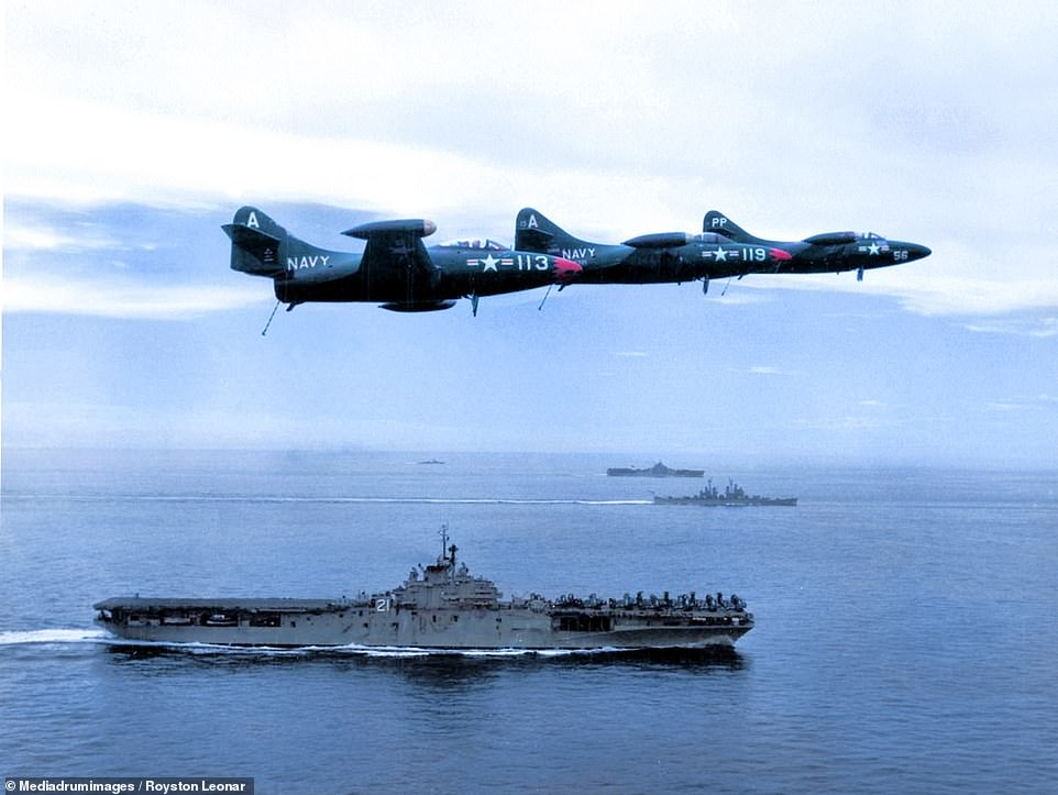 7276704-6482847-At_sea_and_in_the_air_Several_U_S_Navy_fighter_planes_flies_over-a-1_1544542355445.jpg