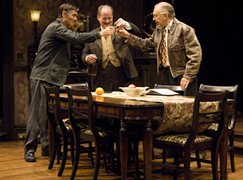 From left, Pike (Mark Murphey), Leo Gordon (Michael J. Hume), and Gus Michaels (Richard Elmore) toast the good old days. Photo: Jenny Graham.