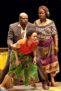 Ruined photo from OSF: Christian (Tyrone Wilson) holds back Sophie (Dawn-Lyen Gardner), who is enraged by the soldiers, as Mama Nadi (Kimberly Scott) looks on. Photo by Jenny Graham