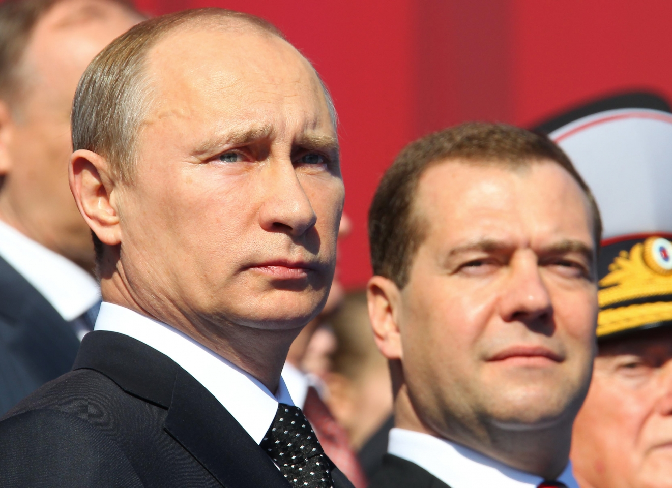 Russian pm putin gestures as president medvedev looks on during a news conference after voting closed in