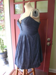 Denim Halter Dress.   100% Chambray cotton. Adjustable spaghetti straps,  button bodice.  Smocked back. $22 shipped  Length 21 inches waist to hem (adjustable bodice length. Waist: 18 inches flat (22 inches stretched) Bust: 19 inches flat (23 inches stretched) Hips : free     Additional pictures upon request