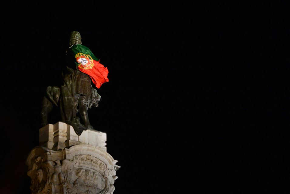 Statue of Marques de Pombal with Portugal's flag