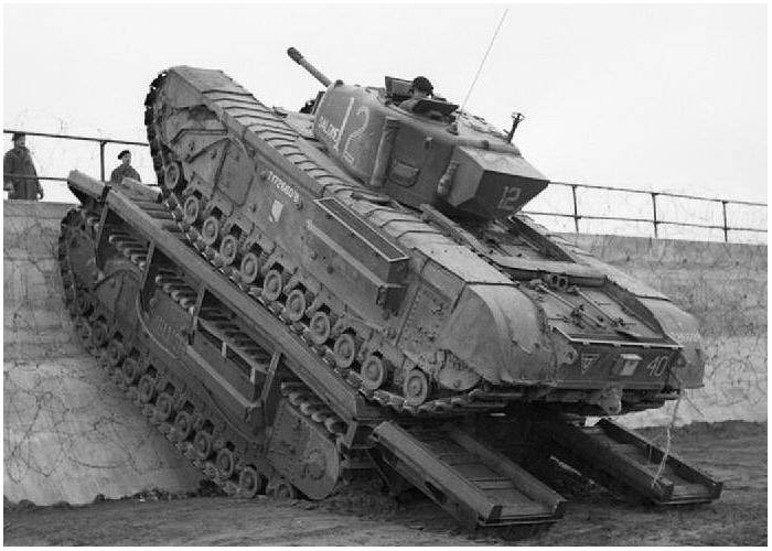 Churchill tank of 79th Armoured Division uses a Churchill Ark to scale a sea wall during trials near Saxmundham, 11 March 1944