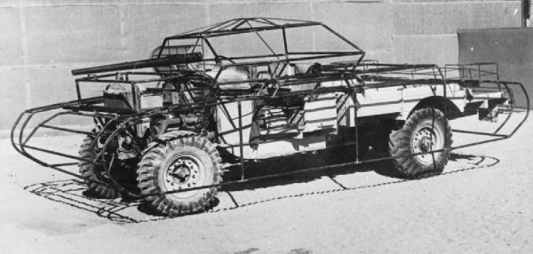 Photograph of a jeep fitted with a metal frame for a wood or canvas cover to masquerade as a tank. Taken by British Army Captain Gerald Leet, 1942, at the Middle East School of Camouflage.
