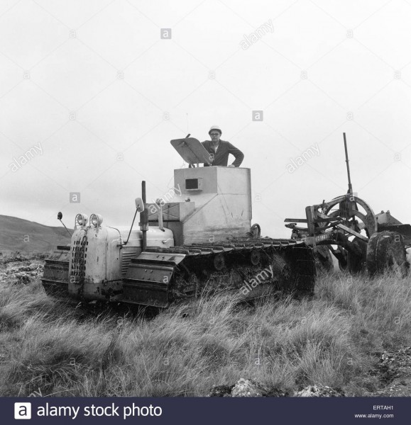 armoured-tractor-ploughing-fields-littered-with-shells-and-bombs-31st-ERTAH1.jpg