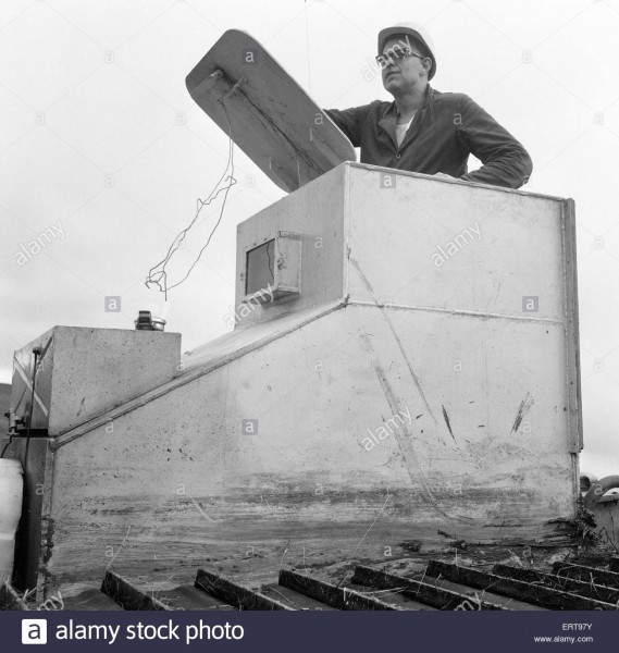armoured-tractor-ploughing-fields-littered-with-shells-and-bombs-31st-ERT97Y.jpg