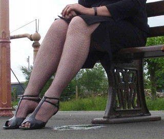 Sitting on a bench, weeing through my skirt while waiting for the train
