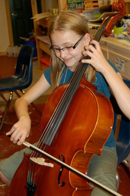 Delia practices her cello at EYMC