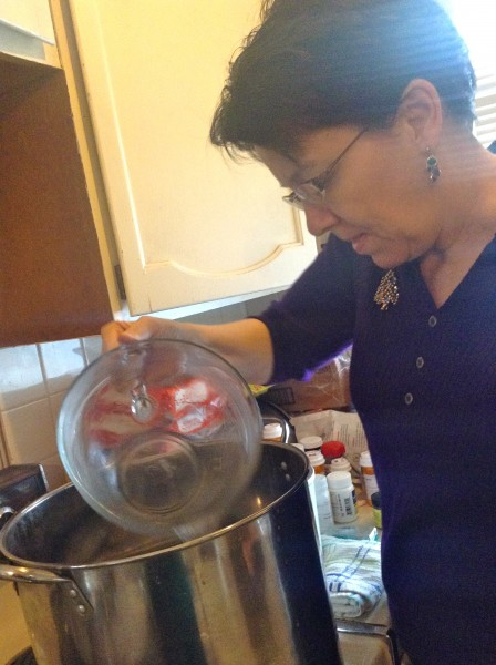 Adding water to the pudding steam pot