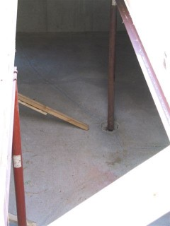 Down into the basement.  The steel beam is on the right, I believe.