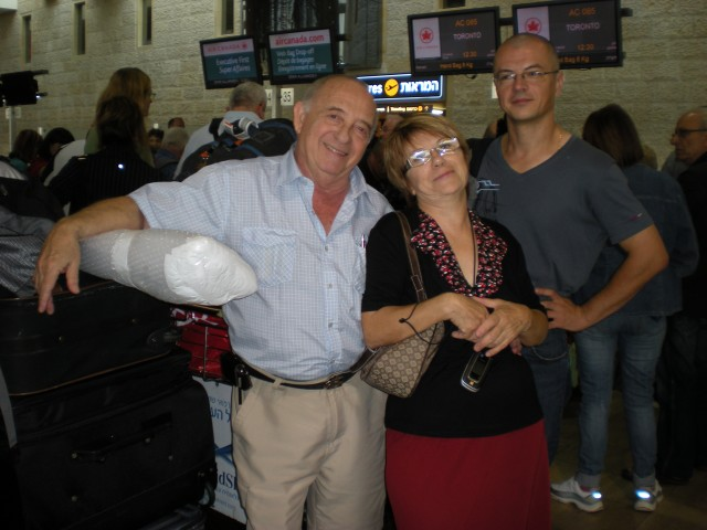 Mom, dad and Danny at the airport. Dad is leaning on our swords!