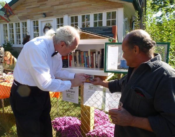 P1180691 Bob & Jose attaching sign