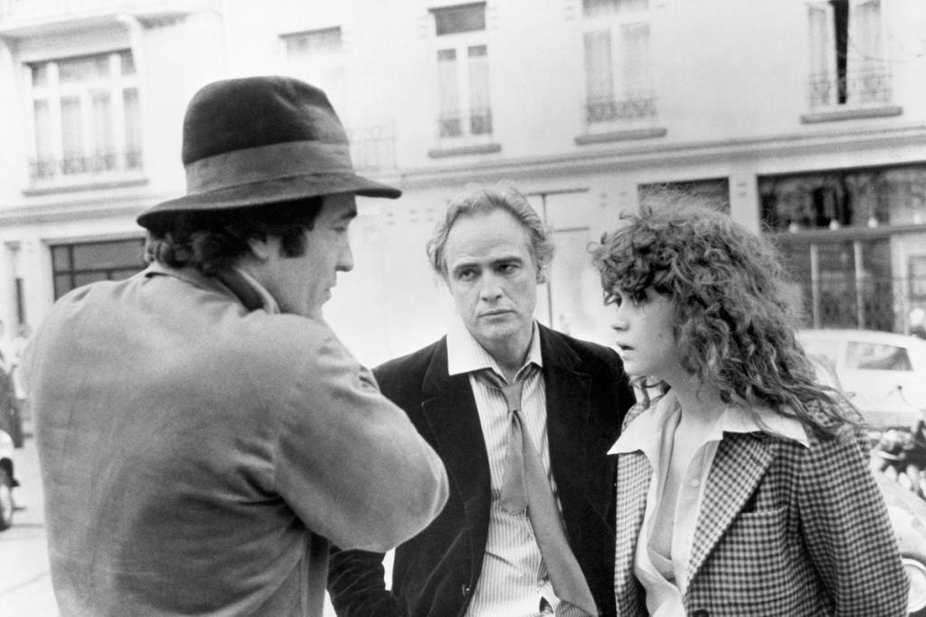 "Бернардо Бертолуччи, Марлон Брандо и Мария Шнайдер за съёмках ""Последнего танго в Париже"""