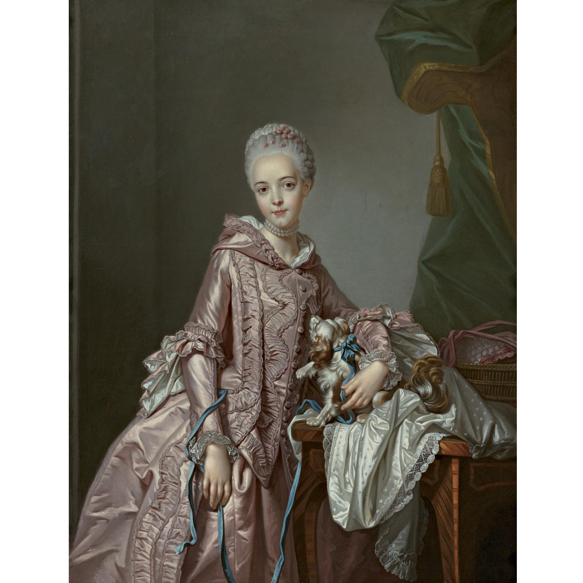 PORTRAIT OF A GIRL HOLDING A SPANIEL