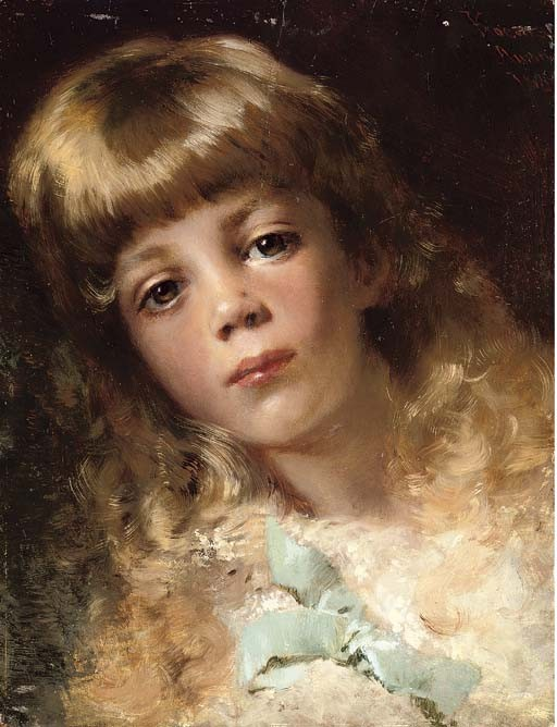 Portrait of a young girl wearing a blue ribbon