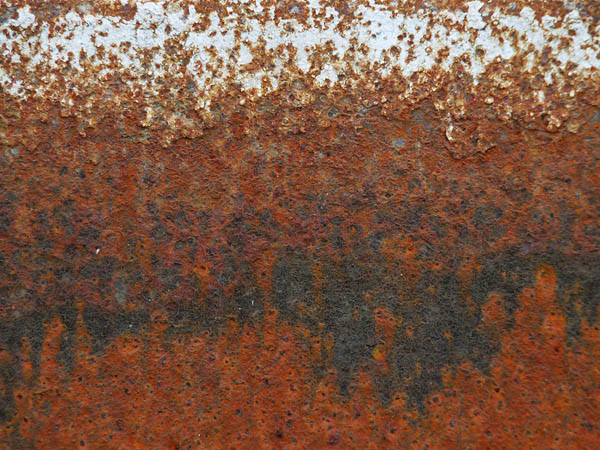 gradations of rust, from grey paint through he usual reddish browns to blackish